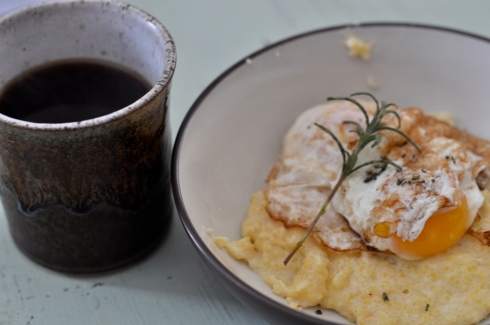 Fried egg, polenta, and black coffee